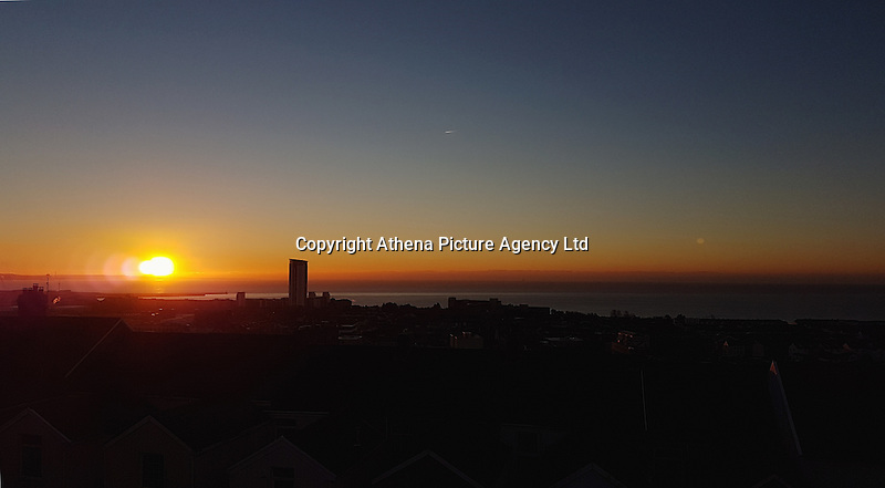 WEATHER PICTURE<br /> Pictured: The sun rises over roof tops in Swansea Bay in south Wales, UK. Tuesday 29 November 2016<br /> Re: Temperatures close to freezing affect parts of England and Wales.