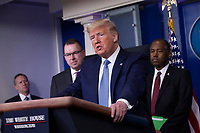 United States President Donald J. Trump makes remarks on the Coronavirus crisis in the Brady Press Briefing Room of the White House in Washington, DC on Saturday, March 21, 2020.  At left is Pete Gaynor, Administrator, Federal Emergency Management Agency (FEMA); and at right is US Secretary of Housing and Urban Development (HUD) Ben Carson.<br /> Credit: Stefani Reynolds / Pool via CNP/AdMedia