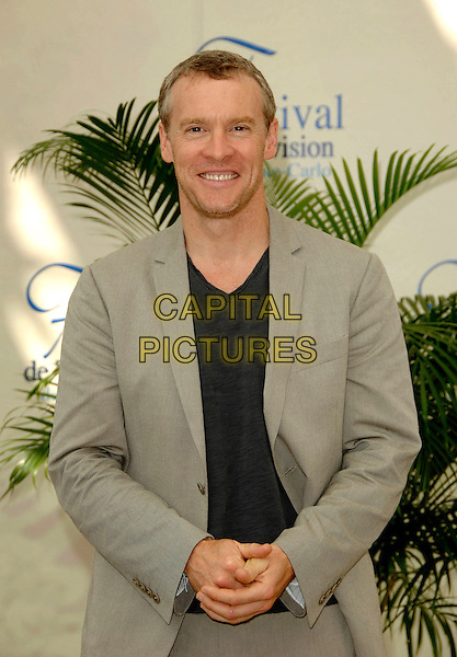 "TATE DONOVAN.Photocall promoting the television series ""Damages"" on the fourth day of the 2008 Monte Carlo Television Festival held at Grimaldi Forum, Monaco, Principality of Monaco..June 11th, 2008.half length beige suit blue top .CAP/TTL .© TTL/Capital Pictures"