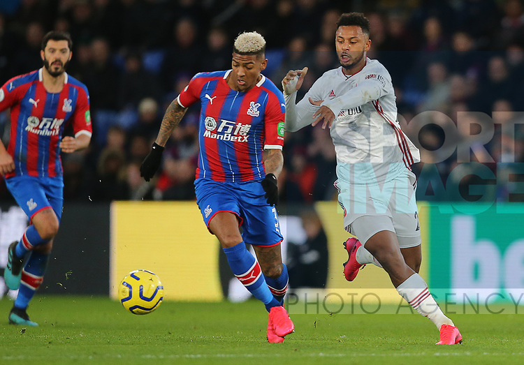 Sheffield United's Lys Mousset and Crystal Palace's Patrick van Aanholt during the Premier League match at Selhurst Park, London. Picture date: 1st February 2020. Picture credit should read: Paul Terry/Sportimage