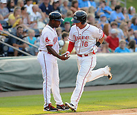 Infielder David Renfroe (16) of the Greenville Drive is congratulated in the dugout after hitting a home run in the second inning of a game against the Rome Braves on July 18, 2011, at Fluor Field at the West End in Greenville, South Carolina. (Tom Priddy/Four Seam Images)