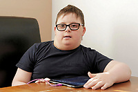 Pictured: Alex Jones. Friday 02 February 2018<br /> Re: 12 year old Alex Jones, who has Down's Syndrome, was not dropped off home by bus company CJ Contract Travel Services but instead was discovered at the company's depot in Barry, south Wales, on his way back from Ysgol Y Deri School in nearby Penarth.