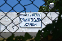 Pictured: The 6th Primary School in Acharnes, Athens, Greece. Friday 09 June 2017<br /> Re: An 11 year old boy has been shot dead by a &quot;stray bullet&quot; during a school celebration in Acharnes (Menidi) area, in the outskirts of Athens, Greece.<br /> Marios Dimitrios Souloukos &quot;complained to his mum&quot; who works as a teacher at the 6th Primary School of Acharnes that he was feeling unwell, he then collapsed with blood pouring out from the top of his head.<br /> His mum tried to revive him assisted by other teachers while his schoolmates who were reportedly upset, were hurriedly removed by their parents.<br /> According to locals an ambulance arrived 25 minutes late.<br /> Hundreds of police officers have been deployed in the area and have raided many properties.<br /> Shells matching the fatal bullet which hit the boy on the top of his head were found in a house yard nearby.<br /> Local people reported hearing shots being fired at a nearby Romany Gypsy camp before the fatal incident.<br /> The area has been plagued with criminality during the last few years.