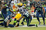 Seattle Seahawks defensive end  Cassius Marsh (91) and strong safety Kam Chancellor (31) attempts to tackle  Green Bay Packers running back Eddie Lacy (27) in the NFL Kickoff Game game at CenturyLink Field in Seattle, Washington on September 4, 2014.  Seattle beat Green Bay 36-16. ©2014  Jim Bryant Photo. ALL RIGHTS RESERVED.