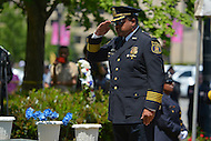 May 10, 2013  (Washington, DC)  Alexandria, VA, Police Chief Earl Cook salutes after dedicating a flower to fallen officers during a ceremony at the Washington Area Law Enforcement Memorial.  (Photo by Don Baxter/Media Images International)