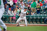 Fort Wayne TinCaps first baseman G.K. Young (15) receives a throw during a game against the Wisconsin Timber Rattlers on May 10, 2017 at Parkview Field in Fort Wayne, Indiana.  Fort Wayne defeated Wisconsin 3-2.  (Mike Janes/Four Seam Images)