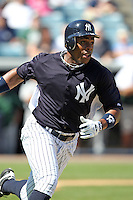New York Yankees outfielder Curtis Granderson #14 runs to first during a scrimmage against the USF Bulls at Steinbrenner Field on March 2, 2012 in Tampa, Florida.  New York defeated South Florida 11-0.  (Mike Janes/Four Seam Images)