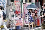 """August 30, 2011 - Tokyo, Japan - A cos-player dressed in a Chinese outfit hands out leaflets on the street in Akihabara. Akihabara is a well-known district in Tokyo for people who have obsessive interests particularly in manga, anime or video games. The Japanese term used for these types of people is called """"otaku."""" (Photo by Yumeto Yamazaki/AFLO)"""