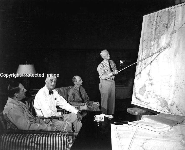 Pres. F. D. Roosevelt in conference with Gen. D. MacArthur, Adm. Chester Nimitz, Adm. W. D. Leahy, while on tour in Hawaiian Islands.  1944. (Navy)<br /> Exact Date Shot Unknown<br /> NARA FILE #:  080-G-239549<br /> WAR &amp; CONFLICT BOOK #:  749