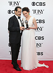 Tony Shalhoub and Katrina Lenk pose in the 72nd Annual Tony Awards Press Room at 3 West Club on June 10, 2018 in New York City.