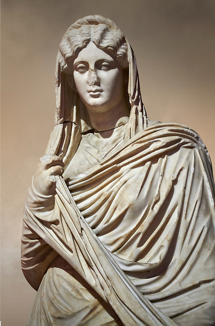 Roman statue of young Faustina. Marble. Perge. 2nd century AD. Inv no 3045 . Antalya Archaeology Museum; Turkey. Against a warm art background.