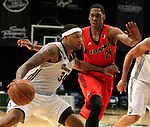 Reno Bighorns Antoine Wright pushes past Idaho Stampede's Paul Carter during a basketball game Sunday, April 1, 2012 in Reno, Nev. Idaho won 108-99..Photo by Cathleen Allison