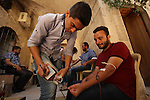 Syrians donate blood at Blood department in the old city of Aleppo, on August 19, 2015. A report from the Syrian Observatory for Human Rights (SOHR) claims that over 1,000 children have been killed in airstrikes during the nation's ongoing civil war, an additional 1.5 million people have been wounded for life in the airstrikes that have been carried out by Syria's government since the Syrian conflict. Photo by Ameer al-Halbi