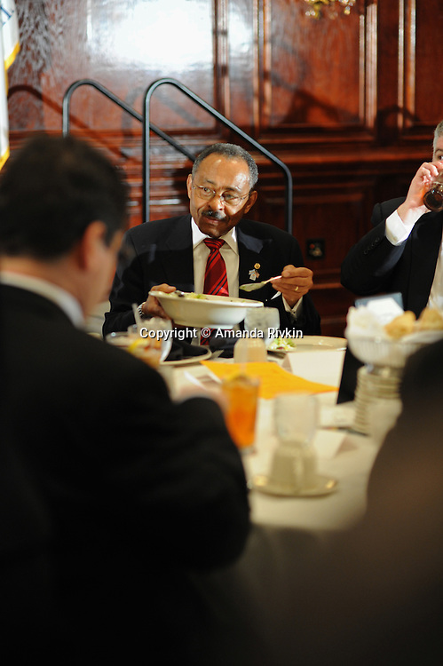 Senator Roland Burris serves himself lunch at Maggiano's restaurant during a City Club luncheon in Chicago, Illinois on February 18, 2009.  Burris admitted in Peoria, Illinois on February 16 to trying unsuccessfully to raise campaign funds for impeached former Illinois Governor Rod Blagojevich while seeking a Senate appointment.
