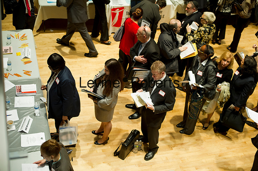 Job seekers attend a job fair on the Upper West Side in New York on Wednesday, March 21, 2012. (© Frances M. Roberts)