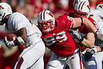 Wisconsin Badgers defensive lineman J.J. Watt (99) tackles a running back for the Minnesota Golden Gophers during an NCAA college football game on October 9, 2010 at Camp Randall Stadium in Madison, Wisconsin. The Badgers beat the Golden Gophers 41-23. (Photo by David Stluka)
