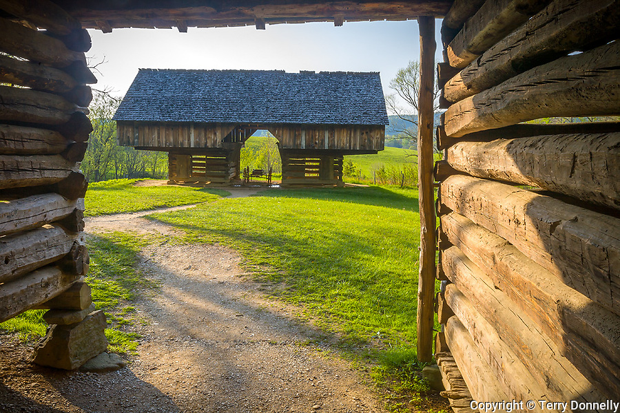 "Great Smoky Mts. National Park, TN/NC<br /> Cantilever barn seen thru a log corn crib bay at ""The Tipton place"" farm site in Cades Cove"