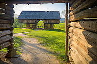 Great Smoky Mts. National Park, TN/NC<br /> Cantilever barn seen thru a log corn crib bay at &quot;The Tipton place&quot; farm site in Cades Cove