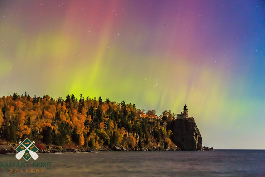 An aurora show over the lighthouse was vibrant but brief until the clouds arrived. The nearly-full moon illuminated the autumn-kissed trees. Lake Superior's gentle waves lapped at the rugged shoreline, and the skies danced overhead.