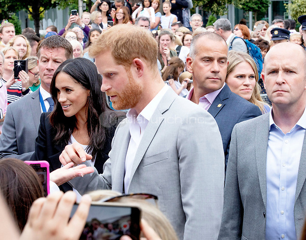 Prince Harry and Meghan, The Duke and Duchess of Sussex leave at the EPIC Museum in Dublin, on July 11, 2018, the interactive museum tells the story of the 10 million Irish people who have emigrated across the world, on the last of a 2 days visit to Dublin  <br /> Photo : Albert Nieboer / /DPA /MediaPunch ***FOR USA ONLY***