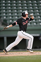 Catcher Lex Tuten (23) of the North Greenville Crusaders bats in a game against the Queens University Royals on Tuesday, March 12, 2019, at Fluor Field at the West End in Greenville, South Carolina. North Greenville won, 14-3. (Tom Priddy/Four Seam Images)