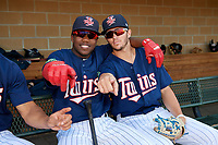 Elizabethton Twins designated hitter Yunior Severino (22) poses for a photo with Colton Burns (23) in the dugout before a game against the Bristol Pirates on July 28, 2018 at Joe O'Brien Field in Elizabethton, Tennessee.  Elizabethton defeated Bristol 5-0.  (Mike Janes/Four Seam Images)