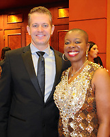 NWA Democrat-Gazette/JOCELYN MURPHY<br /> Candidate Tracey Brown of the large business category poses with John Furner, president and CEO of Sam's Club, at the 15th annual Kiss a Pig Gala benefiting the American Diabetes Association on March 11.