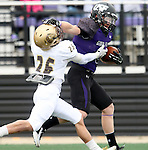 SIOUX FALLS, SD - OCTOBER 18: Brady Rose #5 from the University of Sioux Falls tries to shake a defensive player from Southwest Minnesota State in the first half of their game Saturday afternoon at Bob Young Field in Sioux Falls. (Photo by Dave Eggen/Inertia)