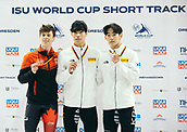 2nd February 2019, Dresden, Saxony, Germany; World Short Track Speed Skating; finals, 1000 meters for men in the EnergieVerbund Arena: Winner Hwang Dae Heon (M) from South Korea at the awards ceremony next to second placed Charle Cournoyer from Canada (l) and third placed Kyung Hwan Hong from South Korea (r).