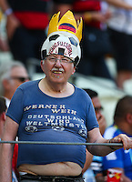 A German fan with a football themed hat and his stomach hanging out