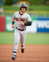 Preston Tucker (9) of the Fresno Grizzlies rounds the bases after hitting a home run during the game against the Salt Lake Bees in Pacific Coast League action at Smith's Ballpark on April 17, 2017 in Salt Lake City, Utah. The Bees defeated the Grizzlies 6-2. (Stephen Smith/Four Seam Images)