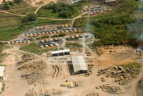 Pará State, Brazil. Aerial view of São Félix do Xingu showing charcoal burners next to a loggers sawmill.