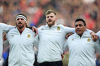 George Kruis of England sings the national anthem with team-mates Tom Wood and Mako Vunipola. Old Mutual Wealth Series International match between England and Argentina on November 26, 2016 at Twickenham Stadium in London, England. Photo by: Patrick Khachfe / Onside Images
