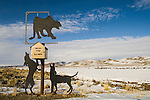 Metal silhouette of a cougar treed by dogs mailbox, Holland Ranch, rural Elko Co., Nev.