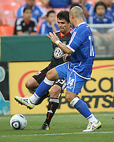 Jaime Moreno #99 of D.C. United passes the ball away from Dennis Alas #14 of El Salvador during an international charity match at RFK Stadium, on June 19 2010 in Washington DC. D.C. United won 1-0.