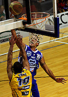 Matt Te Huna shoots under pressure from Shaun Tilby during the NBL Basketball match between Wellington Saints and Otago Nuggets at TSB Bank Arena, Wellington, New Zealand on Sunday, 30 March 2008. Photo: Dave Lintott / lintottphoto.co.nz