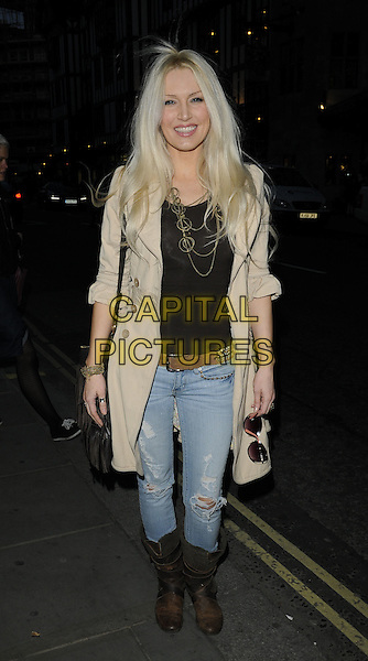 EMMA NOBLE.'Recognise' magazine Launch Party at Swarovski Crystallized, London, England. .April 13th, 2010 .full length jeans denim brown biker boots beige coat jacket top gold necklaces .CAP/CAN.©Can Nguyen/Capital Pictures.