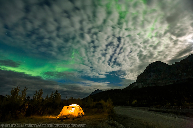 Green northern lights over tent camp in the Brooks mountain range, arctic, Alaska.