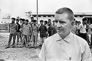 Vientiane, Laos. April 1970. Businessman Ross Perot, founder of Electronic Data Systems, Inc., visits a Prisoners of War camp in Vientiane, North Vietnam. He was appointed by United States Secretary of the Navy John Warner to report on the conditions of Americans in Vietnamese and Laotian POW camps for four years, until the prisoners were released in 1972 at the end of the Vietnam War.