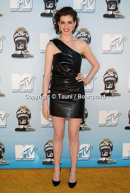 Anne Hathaway - <br /> Press room at The MTV Movie Awards 2008 at the Universal Amphitheatre in Los Angeles.<br /> <br /> full length<br /> eye contact<br /> smile
