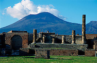 Old ruins of a forum with Mount Vesuvius in the background, Pompeii, Italy.