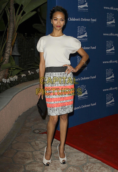Zoe Saldana.The Children's Defense Fund's 21st Annual Beat The Odds Awards held at The Beverly Hills Hotel, Beverly Hills, California, USA..December 1st, 2011 .full length pink white grey gray black top print skirt hand on hip peep toe shoes clutch bag.CAP/ADM/KB.©Kevan Brooks/AdMedia/Capital Pictures.