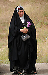 CHAMCHAMAL, IRAQ: A woman attends the funeral ceremony of 104 Kurds discovered in a mass grave...On April 15, 2010, Iraqi Kurds held a ceremony to honor the 102 children and 2 pregnant women discovered in a mass grave near the town of Dibis.  They are believed to have been killed in the 1988 Anfal genocidal campaign against Iraq's Kurds.