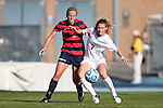 16 November 2013: North Carolina's Kealia Ohai (7) and Liberty's Maddie Boone (2). The University of North Carolina Tar Heels hosted the Liberty University Flames at Fetzer Field in Chapel Hill, NC in a 2013 NCAA Division I Women's Soccer Tournament First Round match. North Carolina won the game 4-0.