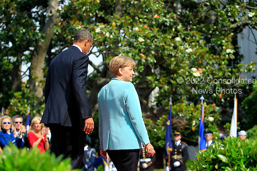 United States President Barack Obama, left, and Chancellor Angela Merkel of Germany, depart after speaking at a welcoming ceremony on the South Lawn of the White House in Washington, D.C., U.S., on Tuesday, June 7, 2011. .Credit: Andrew Harrer / Pool via CNP