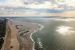 Nederland, Zuid-Holland, Gemeente Westland, 15-07-2012; Delflandse Kust ter hoogte van Ter Heijde en Monster. Maasvlakte aan de horizon, links de kassen van het Westland.De Zandmotor is den kunstmatig schiereiland ontstaan door het opspuiten van zand voor de kust. Wind, golven en stroming zullen het zand langs de kust verspreiden waardoor breder stranden en duinen ontstaan. De zandmotor is een experiment in het kader van kustonderhoud en kustverdediging. .Sand Engine, artificial peninsula build by the raising of sand for the coast of Ter Heijde (near the Hague). Wind, waves and currents will distribute the sand along the coast yielding wider beaches and dunes along the coastline. The Sand Engine is a experiment for coastal maintenance of coastal defense..luchtfoto (toeslag); aerial photo (additional fee required) foto Siebe Swart / photo Siebe Swart