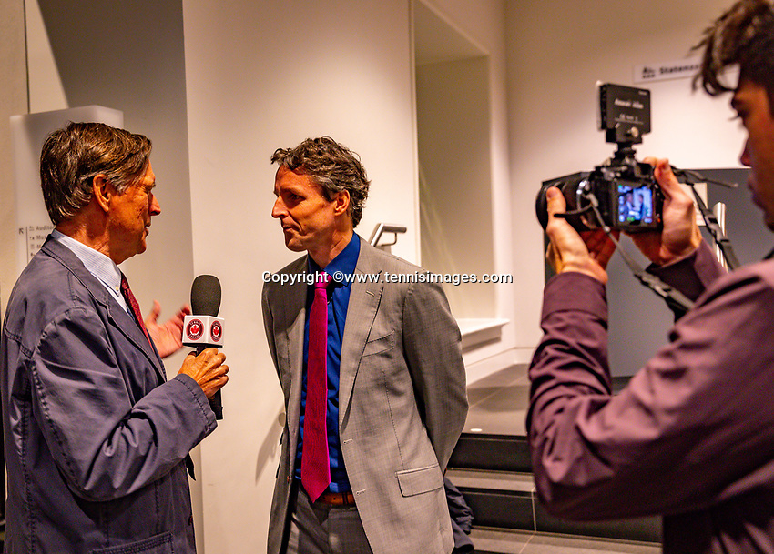 Den Bosch, The Netherlands, Februari 07 2019,  Maaspoort , FedCup  Netherlands - Canada, official dinner, Guus van Berkel being interview by Canadian reporter<br /> Photo: Tennisimages/Henk Koster