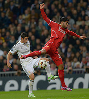 MADRID - ESPAÑA - 04-11-2014: James Rodriguez (Izq.) jugador de Real Madrid de España, disputa el balon con Emre Can (Der.) jugador de Liverpool de Inglaterra durante partido del la UEFA Liga de Campeones, Real Madrid  y Liverpool en el estadio Santiago Bernabeu de la ciudad de Madrid, España. / James Rodriguez (L) player of Real Madrid of Spain vie for the ball with Emre Can (R) player of Liverpool of England, during a match between Real Madrid and Liverpool for the UEFA Champions League in the Santiago Bernabeu stadium in Madrid, Spain  Photo: Asnerp / Patricio Realpe / VizzorImage.