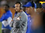 Boise State Head Coach Bryan Harsin coaches against Nevada in the second half of an NCAA college football game in Reno, Nev., on Saturday, Oct. 4, 2014. Boise State won 51-46. (AP Photo/Cathleen Allison)