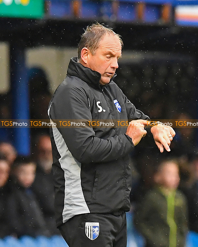 Gillingham Manager Steve Lovell looks at his watch with 2 mins to go during Portsmouth vs Gillingham, Sky Bet EFL League 1 Football at Fratton Park on 6th October 2018
